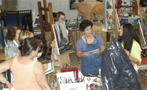 Students in a painting workshop in the United States taught by Niilda Comas.