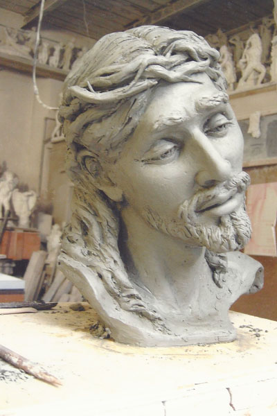 Christ religious sculpture bust in clay